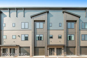 Welcome to Midtown Place condominiums. You will fall in love with these luxury condos just minutes from downtown Grand Rapids. Enjoy amenities like your own private garage, balcony, and assigned guest parking. Desired pen floor plan with a lot of natural light. Spacious kitchen with large center island and solid surface counters. Finishing the main living area is a half bath. Upstairs you will find a gorgeous master suite with large walk in closet, private bathroom, walk in closet and laundry. There is also an additional bedroom and full bathroom. Located within walking distance of restaurants, parks, and grocery stores. Make your appointment today!