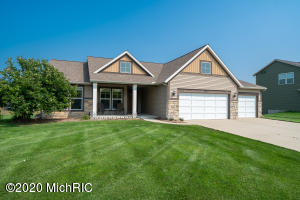 OPEN HOUSE SATURDAY, 8/29, 10:00-11:30.  This open concept ranch home is a must see!  With 5 bedrooms, 3 full bathrooms and over 2500 sq ft of living space there is plenty of room for everyone!  The kitchen features stainless appliances (new gas stove in Feb.) a walk-in pantry and center island.  Walk out the sliders from the dining area to the deck that was just rebuilt this spring with Trex decking.  The master bedroom has an en suite bath with dual vanity, walk-in shower and a spacious walk-in closet.   The daylight lower level offers plenty of natural light.  You will enjoy the family room with a gas fireplace, 2 additional bedrooms and a full bath with a soaker tub.  This home is located in the premier Hidden Shores development with access to a 20 acre lake complete with a sandy beach area.  The neighborhood also offers walking trails as well as common areas for outdoor activities and water access.