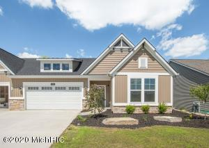 Showings are taking place now for this brand new home plan in Lowing Woods- the Pentwater Condo! A Zero-step, patio style home- perfect for condo living! Glamorous kitchen with appliances included and 8' long island with custom trim and false beams above. Open-concept living area with dual-sided fireplace to enjoy as you relax in the cozy Sun/Michigan Room leading to a covered, screened poured concrete patio- overlooking your nearly all private backyard with rolling hills and mature trees. In addition to the Master Suite with double sinks, tiled shower and walk-in closet, enjoy the use of a 2nd bedroom PLUS an office with stylish barn doors, plus a 2nd full bath. Lowing Woods offers popular community amenities such as an outdoor pool, clubhouse and playground. Maintenance free living can be yours for only $250 per month which covers your water, sewer, trash, summer lawncare and winter snowplowing. $350 one time per year covers the community, clubhouse, pool and playground maintenance.