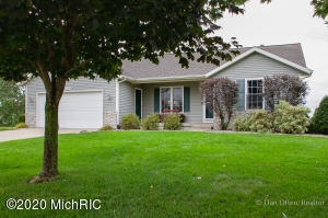 Looking for an easy commute with the convenience of shopping? Check out this walkout ranch on a large, pie shaped lot of almost half acre just 2 miles to Standale Meijer and less than that to I96.A perfect open floor plan with a spacious 25 ft living room as you enter, cathedral ceilings extend over the kitchen as well. Roomy bedrooms avg 13x11.75 and walkout level Family Room is 13'6'' by almost 20'. If you work from home you'll love the office setup with numerous electric & internet outlets, plus surround sound and internet are wired throughout the home. Thanks to technology controlled dual zone heat the gas bill is only $42 a month. Outside are a large upper & lower deck,12x16 storage barn, UG sprinkling, and 300' away is a park with play equipment and room to run. No HOA fee! Open