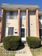 Must see!!! Beautiful condo in lovely Kentwood area with two upstairs bedrooms, huge closets, 1 full bath-upstairs and half bath on the main floor. Living room with dining area opens with sliding doors to patio leading to private backyard. Enjoy for extra space.