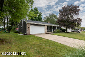 Check out this beautiful updated 3 bedroom, 1.5 bath ranch in the Grandville School district backing up to the Pines Golf Course! Relax on the deck overlooking the golf course & the fenced-in back yard. Enjoy the open floor plan with cathedral ceilings & updated kitchen. Many newer updates including new windows, siding, & gutters with gutter guards in 2019, new roof in 2015, new furnace, kitchen appliances, paint, flooring, kitchen counters tops, bathroom vanity, washer & dryer in 2012. Finished basement with fireplace, kids play room & a flex room that could be used as possible 4th bedroom, exercise room or in-home office. All appliances included. Nothing to do but move in!  Don't miss this one! All offers due Monday, September 14 at 10:00am. Offer's presented at 12:00pm.
