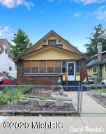 Here's a perfect opportunity to own a classic 20's bungalow w/loads of potential! Three-season porch, vestibule, spacious living & dining rooms w/beautiful original woodwork, kitchen w/appliances included, 2 bedrooms & bath. Larger bedroom has roomy walk-in closet w/built in drawers & storage. Hardwood floor in one bedroom & hall. Living & dining rooms may have hardwood as well. Be sure to check out the attic behind door off dining room. It has high ceilings and cool alcoves-lots of room for expansion. Relax in the backyard beside the pond stocked with beautiful Koi fish. Front & back yards completely fenced. Roof replaced app 2015, furnace app 2014, several windows app 2017. One block from Garfield Park-enjoy disc golf, basketball, baseball, sand volleyball, tennis courts & picnic areas.