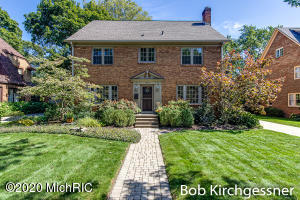 Classic, brick Colonial on one of the prettiest cul-de-sacs in EGR! This 4 bedroom, 3 1/2  bath home has 2618 SQ FT and 3400 total. Every room is generously proportioned.  The home retains its character with hardwood floors, mouldings, fireplace and ample windows - but has been significantly updated by the current owner.   The main floor includes a large, light-filled family room, remodeled kitchen with white painted cabinets, granite counters, stainless appliances and eating area, formal living room and formal dining room. The second floor has a master suite with updated bath with marble, heated floors. 3 large additional BRs and updated family bath.  Walk-up attic has huge potential for additional play/work/studio space. Basement finished to include rec room with built-ins and egress  window, a full bath and laundry both with heated floors! A custom 1000 capacity wine cellar was designed & installed by Wine Cellar Innovations. Private backyard features professional landscaping, pergola and stone patio.  Additional investments include the replacement of all windows with Pella Architect Series and a new roof.  This quiet location is walking distance to schools, Gaslight Village and Reeds Lake.