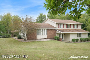 One owner, Quad level home situated on 10 Acres in the heart of Hudsonville. Upstairs includes 4 bedrooms & 2 bathrooms. Heated 30x40-2 story Barn. Ground Water Heat pump & Boiler for Radiant Heat throughout. Natural Gas. Well & Septic. Home is in need of some updates & priced accordingly. Easy to show.