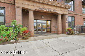 Located in the heart of downtown Grand Rapids, this home boasts high ceilings, beautiful hardwood floors, exposed brick walls, a large wall of windows plus an in-unit washer and dryer. One level, one-bedroom floor plan with a large personal balcony facing north and includes one gated parking lot space. This building offers several perks and amenities including a fully equipped workout facility, rooftop pool and hot tub, a clubhouse with lounge, pool table, and shuffleboard as well as on-site security and mgmt. Union Square occupies almost 2 city blocks in what was Grand Rapid's oldest school building, originally built in 1872 and served as GR's primary high school until 1968. All offers due Monday 9/21/2020 at 12:00 pm.