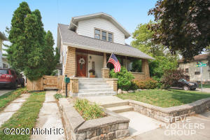 Fall in love with the unique details and charm of this 1920's 3 bedroom, 1 bath, craftsman bungalow. You'll be amazed by all of the original woodwork and hardwood floors, as well as some of the smaller, but thoughtful, details like original light fixtures, glass parlor doors, glass doorknobs and even period-correct switchplates. The huge eat-in kitchen has been updated with the focal point being the two-tone cabinetry, which looks amazing! Buy it today and there'll still be time to enjoy the large covered porch as well as the back deck. Once the snow flies you'll appreciate the 2 car garage and the convenient Westside location in proximity to grocery, restaurants, nightlife, highways and downtown. Schedule your showing before this one is gone!