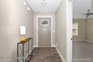 """This condo is Move-In Ready and you can take possession at close!  Meticulously cared for with some custom features you will love.  Two-tone gray and white cupboards adds some character and is accented with beautiful quartz counters and popular gray subway tile.  Flooring looks like a real wood floor and all the carpet is in style and looks like new.  The main floor master has plenty of room for a king size bed and the master bath has dual sinks.  Check out the custom tile work above the shower insert.  A 2nd bedroom or possible office (with everyone working from home) or even an additional den is right off the living room and kitchen.  No worries, there is another full bath and bedroom in the lower level for when guest come to stay. The basement also has a large family room with plenty of space to mount the big T.V. and catch the upcoming football games.  Notice the beautiful custom accent wall!  Everyone is working from home?...how about another custom built office.  This space is like it's out of a magazine.  Wall size desk to accommodate all your working needs.  And if that's not enough, be sure to check out the utility/work room.  The cute detail of the back splash above the utility sink just adds to the cuteness found in this home.  The work bench gives you plenty of room to measure out and finish all those little projects that come with home ownership.  Be sure to notice the cuteness here too. Attached 2-stall garage with 36"""" hallway and Zero step entry. Nothing to do here but move right in!"""