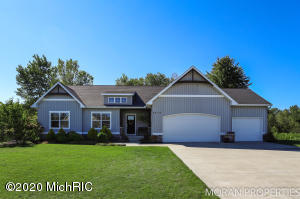 Welcome Home to 2512 Cedar West Dr. in Jenison! You will need to see this one in person!  Step in through the front door to open concept including the living, dining, and amazing kitchen! The mudroom includes a half bathroom, lockers, and a laundry room. Head to the opposite side of the house to find the master suite with en suite bathroom that includes a tub and a shower. Rounding out the main level living quarters is two additional bedrooms and a full bathroom. Be prepared to be wowed as you head down to the walkout lower level. Along with an additional cozy living room including a fireplace, surround sound, and a wet bar, the finished basement also has a workout room, bedroom, and a full bathroom. All of this sitting on a great lot in the sought after Jenison Public School district.