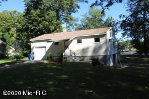 Cute and Adorable are perfect to describe this vacation cottage on the Grand River.  2 Bedrooms 1 Full Bath, open floor plan.  Garage in front and a garage below.  Tons of storage  space.  2 lots included in sale are buildable lots per the seller.