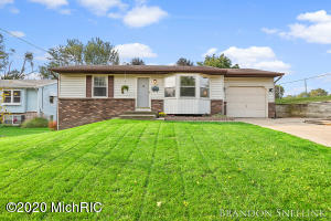 Completely move in ready home on the Northwest side of Grand Rapids.  This home provides 3 bedrooms and 2 full bathrooms with a fully finished basement and attached garage.  Updates through out include paint, luxury vinyl plank flooring, new carpet, stainless steal appliances, fixtures, hardware and the list gos on and on.  Fully finished basement which hosts the third bedroom and second full bathroom with plenty of extra living space and tons of storage.  The exterior provides a low maintenance exterior with brick and vinyl siding, large deck, and a spacious backyard with underground sprinkling.  This home is sure to charm and in a perfect location and neighborhood.  Call today for a private tour or Open House Wednesday 9/23 from 4-6PM.  Any and all offers due Friday 9/25 by 12PM.