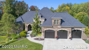Premier neighborhood located on Cascade's walking/biking paths. Very distinguished stone work. 5 spacious bedrooms with a main floor master and 3 1/2 baths. True craftsmanship. High end kitchen w/Granite, wlk in pantry & appliances. Tile & hardwood floors, granite kitchen & baths upgraded lighting package, wainscoting, Landscape & ug sprinkling and outdoor lighting.  Huge mud room w/lockers. 28' deep insulated heated garage. 9'-13' ceilings main floor & 9' in walkout Radiant heated master bath. Designed engineered outbuilding/shed. Lower level finished with high quality amenities. Dual control heating.Covered porch. Gorgeous private  extra deep lot backing up to woods.Spectacular value.