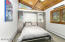 Upper Bedroom features a built-in murphy bed and plenty of storage