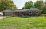 4 Bedroom, 3.5 baths, 1.1 acres (1/2 wooded with pole barn.) Multiple Gull Lake boat docking.