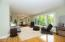 Main floor living room with amazing hardwood floors and Gull Lake waterfront views.