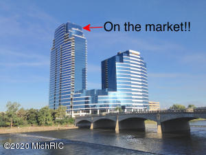 Invest in and enjoy this Grand Rapids premier location. A true penthouse located on the top two floors of Michigan's tallest residential tower. This is a rare opportunity to purchase Grand Rapids finest location. Finished in the minimalist/modern style with quality materials and custom touches. Here, above it all, with contemplative views of the Grand River, you are in touch with earth and sky. A quiet retreat that is also spacious and spectacular for entertaining. Life is good here; you will have 24 hr front desk security service, indoor pool, hot tub, and fitness center. There's a storage unit in the lower level and two dedicated parking spaces right in front of the secure elevator. Also SALE/LEASE BACK: The sellers will entertain sale with lease back. Web page: http://rh3301.weebly.com That could be a long term lease or a short term lease. Let's talk and see what might work for both parties. Call today!