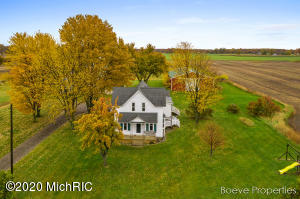 Welcome to this amazing investment opportunity located between Grand Rapids and the shores of Lake Michigan. Over 50 Acres of farm ready land or a new development with 8 parcels and over 1300 feet of road frontage. The immaculate 2 story farmhouse has been cared for by the same owner for nearly 30 years. 2 huge barns for all your farming or storage needs. There are also multiple electric fence corrals perfect for horses or other animals. The home features beautiful hardwood floors, triple pane windows, 13 year old metal roof, 5 year old furnace, tankless water heater, huge bath and laundry, and much more! Custom built in cabinets under the stairs and plenty of storage in the laundry/bath room. Call today to set up your private showing! Video and Audio surveillance is on the property for security purposes.