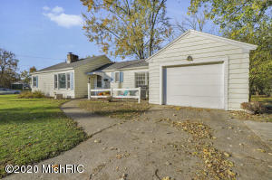 SHOWINGS WELCOME PRIOR TO THE OPEN HOUSE ON SATURDAY, NOV. 7th from 11 am - 1 pm! - This NEWLY RENOVATED 2 - 3 Bedroom Wyoming Ranch with an ATTACHED 1 stall garage is a must see! (3rd bedroom just needs an egress window added!) The main floor not only features 2 bedrooms and a remodeled bathroom but also  a spacious living room boasting tons of natural light! Plus it has gorgeous original hardwood floors recently stained in ebony and has a working fireplace!  In the kitchen you will find freshened up counter tops, a nice backsplash, dining area and the kitchen appliances stay!  For another added bonus there is a sun-filled mudroom which leads off of the attached garage! In the fully finished walk out basement you will find another remodeled bathroom with subway tile, new flooring, vanity and shower!   There is also a laundry area and the Washer & Dryer stay!   Wait! There is more!  There is a Workroom/ Storage area plus behind the lovely sliding barn doors is a 3rd non-conforming bedroom or living room area also with another working fireplace!  (Just needs an egress added if used as a bedroom)  This beautiful home sits on a corner lot with a sprawling side yard and private fire pit area with a low maintenance backyard!  Roof and windows were replaced in 2014!  Stop reading and start calling! *Offers are due by 9 am on Monday, November 9th and will be reviewed later that morning.