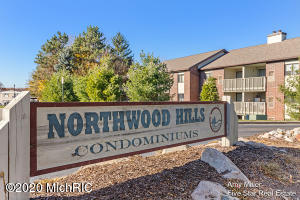Want to feel like you're living on top of the world?  Here's your chance.  This 2 Bedroom 2 Bath 1 Fireplace and 1 Parking Space Northwood Condo is move-in ready.  Tucked quietly away off the East Beltline. This good looking unit is every bit as comfortable as it is convenient. Never more than minutes away from bars, restaurants, Boulder Creek Golf Course,  Grand River fishing kayaking and a host of recreational activities.  Affordable condo fees of $235/month cover all the standards items like water, sewer, exterior maintenance and even cable too.  But it provides you with a lifestyle which includes access to pool, clubhouse and hot tub.  Winter hours can be spent cozied up to your own fireplace reading and watching your favorite shows. Master Bedroom includes walk-in closet.  Don't miss!