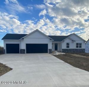 Come see this beautiful new ranch in Sessions Pointe! This 3 bedroom, 2 and 1/2 bath home with an unfinished basement is almost ready for you to move in! Located in the fantastic Grandville school district, while also being minutes from downtown Grand Rapids.