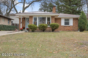 ***Multiple offers received highest and best offers due by 11/14/2020 at 7pm*** This beautiful brick ranch home with a steel roof is the charmer you have been looking for! Walking through the front door the original hardwood floor invites you into the spacious living room with a wood burning fireplace and a dinning room area big enough to entertain family and friends. The kitchen has been recently updated with an eye catching butcher block countertop, backsplash and a hard to find walk-in pantry.  All main floor bedrooms are great size and the bathrooms retro design is the icing on the cake. Don't miss the 3 seasons room that provides picture window view and access to the backyard.