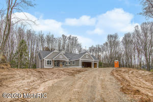 This designer walk out ranch presented by Schultz Builders features a private 3 acre wooded location with just under 4000 sq ft designed with functionality with open concept floor plan providing a great gathering space, living room featuring fireplace with build ins on both sides. Kitchen encompasses large center island, solid surfaces, pantry, built in desk with large dinning area. Master suite is on opposite end of the other 2 main level bedrooms which gives option to use one as an office/den. Walkout basement with 9 ft ceilings, amazing layout for entertaining with bar area, wine cellar. family room and gaming area. Two additional bedrooms/office or workout rooms complete this fully finish space. Will be completed beginning to Mid Dec interior pictures are of prior build