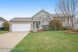 ***Highest & Best Offer Deadline 11-21-20 at 10:00am.*** Nicely updated 4 bedroom 2 bathroom home tucked away in a quite neighborhood close to everything and Gaines Twp taxes! This bi-level features an open floor plan with cathedral ceiling, bamboo wood flooring in the kitchen, great room and hallway. Spacious kitchen with pantry, center island w/snack bar, all appliances included, plus a roomy dining area with sliders to deck. The main floor master bedroom is attached to a walk though bathroom with tile floors. The lower level family room has sliders to large patio, which is perfect for entertaining. This level also includes two more bedrooms and second full bath with separate laundry room. Nicely landscaped yard with underground sprinkling and fenced backyard. New roof in 2017.