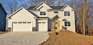 This awesome Marcusse Construction home in Hudsonville Schools is nearly complete! You will enjoy the open concept main floor design that nicely flows between the living and kitchen areas. Upstairs there are 4 bedrooms including a master suite that you have to see to appreciate complete with soaking tub, walk in tiled shower and walk in closet! The laundry is also conveniently located upstairs so there is no hauling laundry up and down the stairs. Completion is scheduled for December 2020. Come and check it out today!