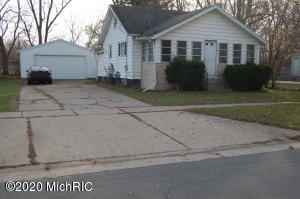 ''Move in ready 3 BR home situated on a lot & a half''. Washer, Dryer, Stove/Oven, & Refrigerator stay with home.  Enjoy the Spacious 24'X24' Two Stall Garage w/extra storage & working area. Enjoy the extremely large double wide cemented driveway which is 86' long & 15'6'' wide providing plenty of area to PARK &/or PLAY basketball, soccer, hockey, and ride bikes etc.   Enjoy the Large fenced in back yard-great for playing, grilling, entertaining, & to put in your own garden. Kitchen has plenty of cupboards & countertop area.  Large bedroom on main floor with 2 cozy smaller bedrooms upstairs.  3 seasons room.  Large living room & dining area.  The basement has about 570sq f of additional storage area w/ a toilet. Only 4 miles from Downtown GR & close to many restaurants & businesses