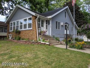 This home has hardwood floors, new kitchen tile,  and countertop, new paint, newly redone lower level, new hot water heater 2015, new roof 2016, new furnace 2014.  Ready for you to move right in.  Fenced in backyard, 3 stall garage with plenty of room for your toys.  Front porch newly carpeted and trimmed, back patio newly landscaped and ready for gathering around fire pot.  Make time to see this home.