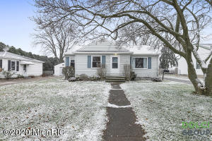 This inviting and charming 3 bedroom/2 bathroom ranch, with oversized two stall garage,  boasts attractive neutral decor, well appointed galley kitchen with stainless steel appliances, and an abundance of newer features including, but not limited to, the following:  roof, windows, garage door (2017), and lower level carpet (2016). Enjoy the arched doorways and beautiful hardwood and tile flooring. The sliding door off the dining area leads to a sizable fenced yard. In addition to the comfortable main level, the lower level displays a finished family/recreation area, two office/non-conforming bedrooms, and a full bathroom. Clean home! Convenient location! Completely ready to call your own!