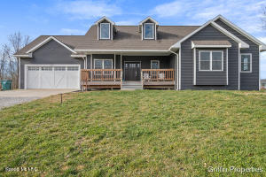Beautiful, custom-built walkout ranch in Allendale!  This 3 bedroom, 2 full bath home built in 2017 offers open concept living, tons of natural light and an expansive back deck, perfect for entertaining, overlooking the 1.89 acre lot. The spacious front porch welcomes you to the main floor consisting of a large living room, formal dining area, laundry room, large bedrooms and spacious kitchen with breakfast nook.  The kitchen features stainless steel appliances, plenty of counter space and a large pantry.  The open shelving and deep storage drawers add to the incredible appeal of the space. The owner's suite not only has a large closet, but leads into a private, custom bathroom with dual showerheads, soaking tub and a double vanity.  Thoughtfully chosen fixtures, beautiful built-ins throughout and has been meticulously maintained - not to mention located less than 30 minutes from Lake Michigan and less than 30 minutes from all that downtown Grand Rapids has to offer!