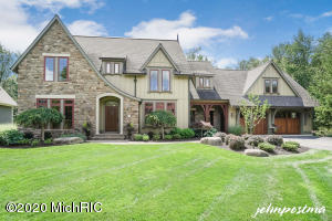 MANCHESTER HILLS - Custom Colonial Builders home designed by Jeff Visser. Situated on a private cul-de-sac overlooking common natural preserve. Abundance of detail & trim work. Gourmet Chefs Kitchen w/ Center Island & Graber Cabinets opens up to Family Room w/ Fireplace & knotty pine vaulted ceiling. Large Back entry Locker Room. Upstairs Master Suite w/ Sitting area. Upstairs Laundry w/ 2 additional bedrooms & Jack/Jill Bath. $75K spent in recent Lower level walkout finishing which includes 10 ft. ceilings, Bedroom, Bath, & Family Room. Lower Level Garage for Workshop/Craft Rm.  Whole house Audio. New Paint throughout. Heating. EPS. Central Vac. Solid Wood Doors. 3/4 in. Brazilian Cherry Floors. Brick Pavers. Copper Gutters. Wood Carriage Doors. Epoxy Garage floor coating.