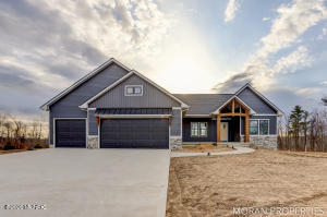 New Construction!  This Curt Moran Builder 3 bedroom, 2.5 bathroom home is located in the new Traders View development in Allendale. Bylaws allow up to a 36x48 pole barn if desired. Did I mention the common area by the Grand River? With 1741 square feet on the main level, this layout defines open concept! The master suite is tucked away on the opposite side of the house from the other two bedrooms. Head downstairs to the unfinished walkout lower level! All of this sitting on the beautiful 1.17 acre lot with views you need to see in person!
