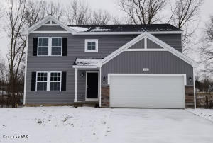 New construction to be complete April 2021.  This is currently the ONLY home available in this price point in Hudsonville SD. 4 bedroom, 2.5 bath home in Creekside Shores, an amazing new community located in the Hudsonville SD. The community is ideally situated for commuters to both GR and Lakeshore. RESNET ENERGY SMART NEW CONSTRUCTION, 10 YEAR STRUCTURAL WARRANTY. Welcome home to over 2,000 square feet of living space.  The foyer welcomes and leads into a large great room, open to the gorgeous kitchen, featuring castled cabinets, a center island with pendant lighting, granite counters, tile backsplash and spacious dining nook. The large mud room is a multi-functional space, tucked away from the main living space, and includes a WIC, laundry room as well as a powder room. Upstairs find a large master suite with a WIC and private full bath. 3 more spacious bedrooms and another full bath compliment the master and provide plenty of space for family and guests. Walkout basement.