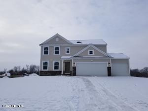 New construction ready to move in Feb 2021.  Home is 1 year newer, 254 sq ft larger and $37 sq ft less than comps, a must see!  3 bedroom, 2.5 bath, 3 car garage home in Spring Grove Farms, located in the Hudsonville School District. In this ideal setting you can enjoy the peace and quiet of country living but are just minutes to the city and all of life's conveniences.  Outstanding location also allows for easy access to both Grand Rapids and the Lakeshore. RESNET ENERGY SMART NEW CONSTRUCTION, 10 YEAR STRUCTURAL WARRANTY. Entertaining or enjoying a night at home, this open floor plan has space for everyone. Large great room is open to the dining nook and kitchen. Kitchen features a center island, granite counters, tile backsplash and SS; dishwasher, range and microhood. Easily accessed from the kitchen are the mud and laundry rooms. Stylish powder room completes the main floor living space. Upstairs a master suite awaits, with a private, full bath and large WIC. 2 more bedrooms, open space game room and another full bath complete the upper level. Walkout basement.