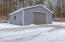 32'x40' concrete floor pole barn with ample parking, 12' door, plumbed, heated, electric