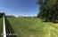 Looking SW from North driveway approach over an expansive 2.2 acre pasture.