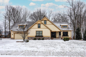 This former Parade Home built by none other than award winning Koetje Custom Builder will take your breath away. Meticulously cared for 5 bed/3.5 bath home with over 3500 square feet of custom designed living space on a private setting, in ever so popular Railside West golf community.  Peer out the oversized windows to the tree lined private backyard. Main floor exceptional details include enormous kitchen island with granite countertops, stainless steel appliances, walk-in pantry, solid wood doors, trance windows and new wood floors. Living room will impress with stunning stone fireplace, beautiful built-ins, inlayed ceiling and surround sound. Bright and elegant master suite with large walk-in closet, superior master bath and enormous windows. 2 more large bedrooms, full bath, and laundry complete the main floor. Lower level is ready for entertaining with wet bar, family room, giant windows, 2 more generously sized bedrooms, full bathroom and plenty of storage.  Warm, homey, yours!5th bedroom can be a workout room, home office or anything you want it to be! Golf course access to golf course and clubhouse/pool.  Golf and pool membership benefits with living in Railside West.Garage is complete with sealed floor for a non slip surface and custom blinds to match the house.