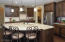 large Island with granite countertops and ample seating
