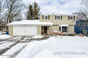 This Beautifully Updated East Grand Rapids Home is located within walking distance to Schools, Gaslight Village, shopping, restaurants and parks while offering over 3000 sq. ft of comfortable living space to spread out and enjoy life.  This spacious 5BR, 3.5 bath includes an open floor plan and a guest suite in the walkout lower level (or home office). Sellers have completed many updates including professional paint throughout, refinished hardwood floors, newer flooring on the main level, updated kitchen (fixtures, appliances, lighting, countertops), newer windows, new driveway with drain and new Roof.  All of this on a large lot make this home a rare find in East Grand Rapids. Main level features two living areas, dining room and kitchen with additional eating space. Upstairs you will find a master ensuite, 3 additional bedrooms and full bath. The finished, walkout lower level houses the laundry room, another family room with built-ins and a guest suite with bedroom, bath, kitchenette and living space that walks out to backyard. There is also a large storage room in the lower level (home gym). This home presents a unique opportunity to live AND entertain! Showings start Friday 1/29/21.