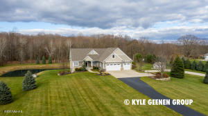 We are excited to present, for the first time ever on market, 6525 Tyler Street! This testament to craftsmanship is the peaceful retreat you've been looking for!  Nearly 9 acres of woods with trails, vineyard and much more.  Wake up to a sunrise on the pond coupled with the soothing sounds of wildlife in unmatched privacy. In the highly desirable Hudsonville School District - this distinguished home has an open living space with coffered ceilings, chef's kitchen, expansive master suite with heated floors and a steam shower.  The walk-out lower level boasts a theater family room with black-out shades, 3 bedrooms and a heated lower garage. UNFINISHED BONUS ROOM ABOVE GARAGE. Contact us for details.  All of these details and many more add to the exquisiteness of this one-of-a-kind property!