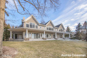 Expansive Lake Michigan home on 1.94 wooded acres with 132 ft of private frontage, lakeside deck & beach stairs. Open concept main living area with sweeping views of Lake Michigan. Four master suites with lake views to choose from, one of which is on the main floor. Floor to ceiling windows throughout the main and upper level afford the best views of the water and vivid sunsets. Upper level includes 3 master suites with vaulted ceilings, 2 bedrooms with a jack and jill bath, and a bonus family room that could be converted into the 7th bedroom. Kitchen offers plenty of room with a 6-burner Wolf cooktop island, and two-tier seating island. Covered lakeside porch adds an additional 1,300 sq. ft of outdoor living area. Finished rec room area on lower level. Shared use of tennis courts.
