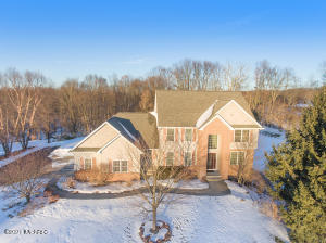 Visit this stunning 2 story home w/ a 3 stall garage resting on a 1.7 acre lot overlooking wooded areas. Main floor offers: Lv Rm, Dn Rm, Fam Rm, Eating Area, Kitchen, 1/2 bath & MFL w/sink. Granite counters, & Island, crown molding, recessed lighting, SS apps, hardwood flooring, gas-log FP & built ins.  Second floor features:  Large Master Bed Rm, Master Bath w/whirlpool tub & double bowl vanity. 3 additional spacious bedrooms, large closets & 2nd full bath room. Large, open LL walk-out offers:  Dining area, work out room, rec room, ktichen/bar area, built ins, 3rd full bathroom and sliders to large backyard. The large rear deck overlooks backyard & beautiful 18x36 inground pool w/ new liner 2017, heater 2015 & pump 2016.  Additional features:  All appliances stay, UG sprinkling, spacious 3 stall garage & sturdy back yard storage shed. Beautifully landscaped property & an expansive western view out front