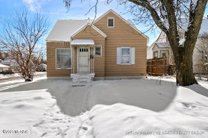 Large 3 Bedroom Home With Full Basement Large Dormer Master Bedroom. Nice Corner Lot And Convenient Location. Newer Windows, Furnace And Electrical service. Needs a little TLC, However A Good Value. Larger Than It Looks.