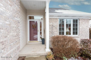 If you are looking for an inviting space with a well thought out floor plan, this is a must see! You won't want to miss this meticulously maintained and elegant condo in sought after Maple Grove.This community is  conveniently located to shopping and dining near Knapp Corner.The main floor offers a large living room with gas fireplace and vaulted ceiling providing an abundance of natural light through the skylights.You will be drawn to the beautiful light filled sunroom on the south side of the unit. A generous  dining area and kitchen with new appliances and hardwood floors, sitting room (or office), master bedroom and bath with a large walk- in closet, half bath with laundry hook up finish off the main level. In the lower walkout level, you'll find a spacious living area, bedroom, full bath, and plenty of storage.  An attached 2 car garage completes the condo.