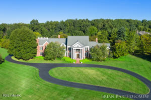Ada Twp's ''Crown Jewel'' offered for $3,995,000.  2 owners, Immaculate Condition. All Brick, 13,000 sq/ft. 10 acres with irrigation & professionally manicured. Organic Garden. In-ground Garter Pool with Gazebo. This estate was constructed by the finest Artisans & modeled after Royal Estates in Europe. $250,000 one of a kind Stair Case, Mechanically upgraded, w/ superior efficiency, Boiler system with 9 new air handlers, 9 new a/c units, Scott Christopher remodeled Kitchen. 4 Fire places Less than 10 minutes to downtown Grand Rapids and major shopping. Award winning Forest Hills Schools. Bonus: 2b/2b Carriage House with 1250 sq/ft. This property cost $4.4m to build in 1993. All buyers & buyer agents to furnish a pre-approval letter to the listing agent prior to an accepted showing request.