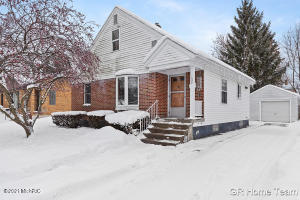 Close to downtown in popular NW side. This 3 bedroom/2 bath 1950's home checks a lot of boxes for most buyers! No big ticket items to worry about-newer furnace/central air (2020), water heater (2018), Pella windows, &  roof approx. 8 years old.  Wonderful charm and great floor plan with entry areas, living room, dining area, spacious kitchen with plenty of counter & cupboard space, 3 good-size rooms, 3-season sunroom and room to finish basement. One full bath on main floor, one in basement with shower (see photo) and room to add one in upper bedroom (see closet space). Also, hardwood floors on main floor. A quaint backyard with some privacy, one-stall garage and sidewalks to take you downtown or to Fulton St. businesses. Offer deadline noon Monday Feb 22nd. No offers reviewed before then.