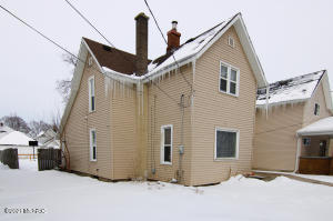 Beautiful and spacious 4 bedroom home int he up and coming West side of Grand Rapids.  The main level boasts a formal dining room, flowing kitchen, cozy living room, bedroom and a full bathroom. You'll love the classic hardwood floors and old-world character.  The upper level has three good-sized bedrooms and a full bath with laundry.  Since there is a long-term tenant in place, this home is perfect for a single-family investor or the owner-occupant who would have flexibility on moving date and would like to collect rent from an excellent tenant until lease expiration