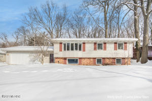 Check out this beautiful home in NW Grand Rapids, this is not your typical Bi-level home, the foyer is spacious with a big storage closet, the Kitchen is open to the living room with a large dining area and glass door out to a deck with a gorgeous view of the woods with plenty of wildlife to watch. The main floor consists of a large master bedroom with dual closets, another bedroom and full bath. The lower level has a big Family room with a gas fireplace, office with built ins, bedroom, full bath and large laundry room with a door out to the back yard. Comes with efficient heating & cooling units with brand new AC unit. Close to highways, downtown, but also surrounded by nature. Seller has instructed agent to hold all offers until February 22, 2021 at 5 pm with an answer the next morning.